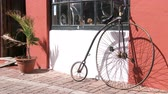 maritime territory : Old velocipede standing beside traditional building in the small town of St. George, Bermuda