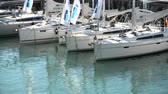 посетителей : Sailing boats docked during the Genoa Boat Show, the most important exhibition of boats in Italy