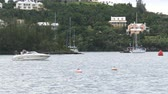 maritime territory : Boat navigates in front of the Bermuda yacht club during Americas Cup sailing series