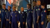 missão : Italian astronauts take a picture before a conference at the 55th anniversary event of the aerobatic demonstration team of the Italian Air Force