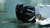 vysvětlující : Powerful outboard engines on a RIB navigating slowly