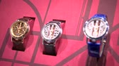 watches : New models of elegant watches exhibited at Corum booth at Baselworld watches and jewelry show in Basel, Switzerland. Stock Footage