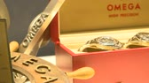 watches : Vintage watches exhibited at Omega booth at Baselworld watches and jewelry show in Basel, Switzerland. Stock Footage