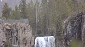 Footage of the top of Tumalo falls in the winter.  A viewpoint on the left, the forest on the right and the falls in the middle. Stock Footage
