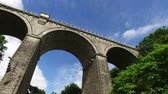 旅遊 : Facing upward perspective of driving under tall Cornwall Railway bridge in Newquay. 影像素材
