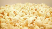vajas : Golden Popcorn Rotating Slowly In Bowl