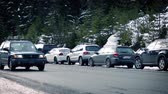 evening : Car Passes Row Of Cars In The Snow Stock Footage