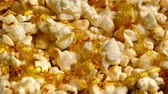 масло : Liquid Butter Pours On Box Of Popcorn