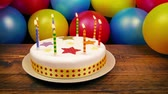 açoitado : Birthday Party Scene With Cake And Balloons Stock Footage