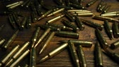 violência : Passing Bullets On Table Stock Footage