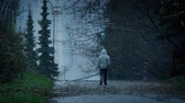 несчастный : Man Walking On Cold Wet Day