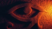 egyptisch : Egyptian Eye Carving Lit Up With Fire Torch Stockvideo