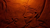 Pharaoh Stone Carving In Fire Glow