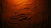 mýtus : Carved Stone Dragon In Fire Glow