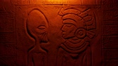 Fire Lights Alien And Aztec Man In Wall Carving Stock Footage