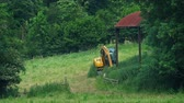 Farm Landscape With Digger And Old Shed