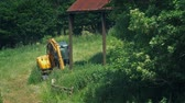 Farm Field With Old Shed And Digger Stock Footage