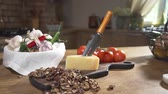 молочный : Still life with cheese and nuts, cooking food, food on the kitchen table, cooking at the country side Стоковые видеозаписи
