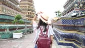 reap : Asian tourist women travel in Buddhist temple with backpack and sun hat Stock Footage
