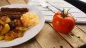 croata : Serbian cevapi, cevapcici, Balkan minced meat kebab on a white plate with marinated cabbage Stock Footage