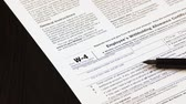 Tax reporting. Tax form on wooden background Стоковые видеозаписи