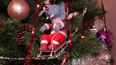 noel kartı : New Years composition, Christmas decorations. Christmas toy elephant on a sledding hangs on a decorated Christmas tree on the background of a blinking garland and other toys. Close-up