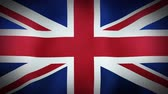 страна : The United Kingdom flag blowing in the wind. Seamless loop.