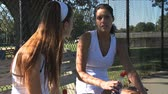 concorrentes : Two competitors during and after a tennis match Stock Footage