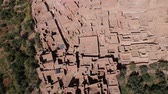 kasbah : Flying near Ait-Ben-Haddou at Morocco with Drone - Ait-Ben-Haddou from above Stock Footage