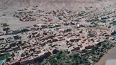 eski şehir : Flying near Ait-Ben-Haddou at Morocco with Drone - Ait-Ben-Haddou from above Stok Video