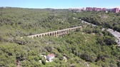 uav : Flying with drone over beautiful Nature with old Aqueduct bridge at Tarragona and Spain | 4k