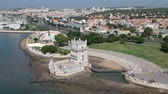 lisboa : Flying over Torre de Belem with Drone in Lisbon and Portugal Stock Footage