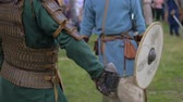 cavaleiro : Men in armor preparing for battle close up Stock Footage