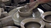 cruche : Potter Creates the Product on a Potters Wheel. on the Potters Lathe Spinning Pottery.