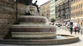 statue : Fountain on the urban street with cars in the background Stock Footage