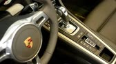 luxus : dashboard, wheel,shift(gear) lever and detail of logo - Porsche 911 Turbo