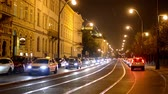 asphalt : night city - night urban street with cars and trams - lamps(lights) - car headlight