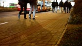 passeio público : people walking on the street night - closeup legs - road with cars