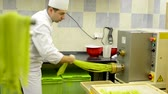 industrial : production of pasta  machine produce pasta  chef makes pasta pull out from machine
