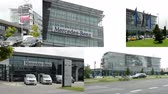 moderno : PRAGUE, CZECH REPUBLIC - AUGUST 2014: 4K montage (compilation) - headquarter of Mercedes Benz - part of the building with sign and logos - parked cars - ubran street with cars