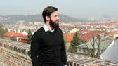 casual : young handsome man with full-beard (hipster) walking in park and looks on the city - city in background Stock Footage
