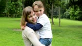 parent : Pretty mother with little son smile to camera - park Stock Footage