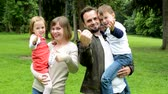 parent : family middle couple in love, cute girl and small boy welcome in the park