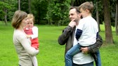 man elstv : family middle couple in love, cute girl and boy together small talk in the park Stock Footage