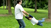 man elstv : Father rotate with son little boy around - park Stock Footage