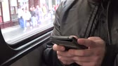 man elstv : man travel by tram and works typing on smartphone - city - closeup hand