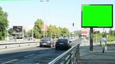 anlamlı : CZECH REPUBLIC, PRAGUE - JULY 3, 2015: The billboard close the busy road in the center of city - green screen