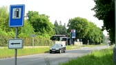 galão : CZECH REPUBLIC, PRAGUE - JULY 5, 2015: The camera focus road sign petrol station in the countryside - around pass cars and bike Vídeos