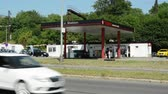 galão : CZECH REPUBLIC, PRAGUE - JULY 7, 2015: The view of the Texaco gas station in the suburb - surrounded by trees