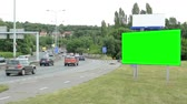 anlamlı : CZECH REPUBLIC, PRAGUE - JULY 8, 2015: The billboard stands by the road surrounded by trees - green screen - breeze blows - timelapse Stok Video